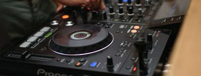 a dj using his decks
