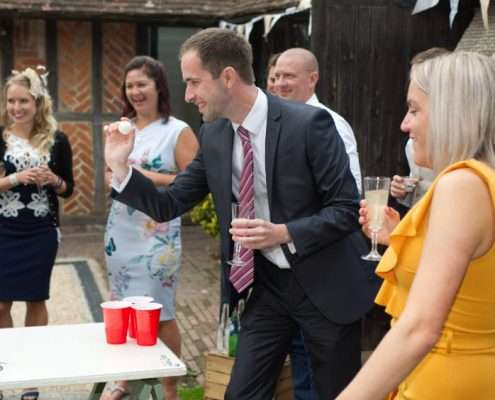 a guests playing beer pong at a wedding