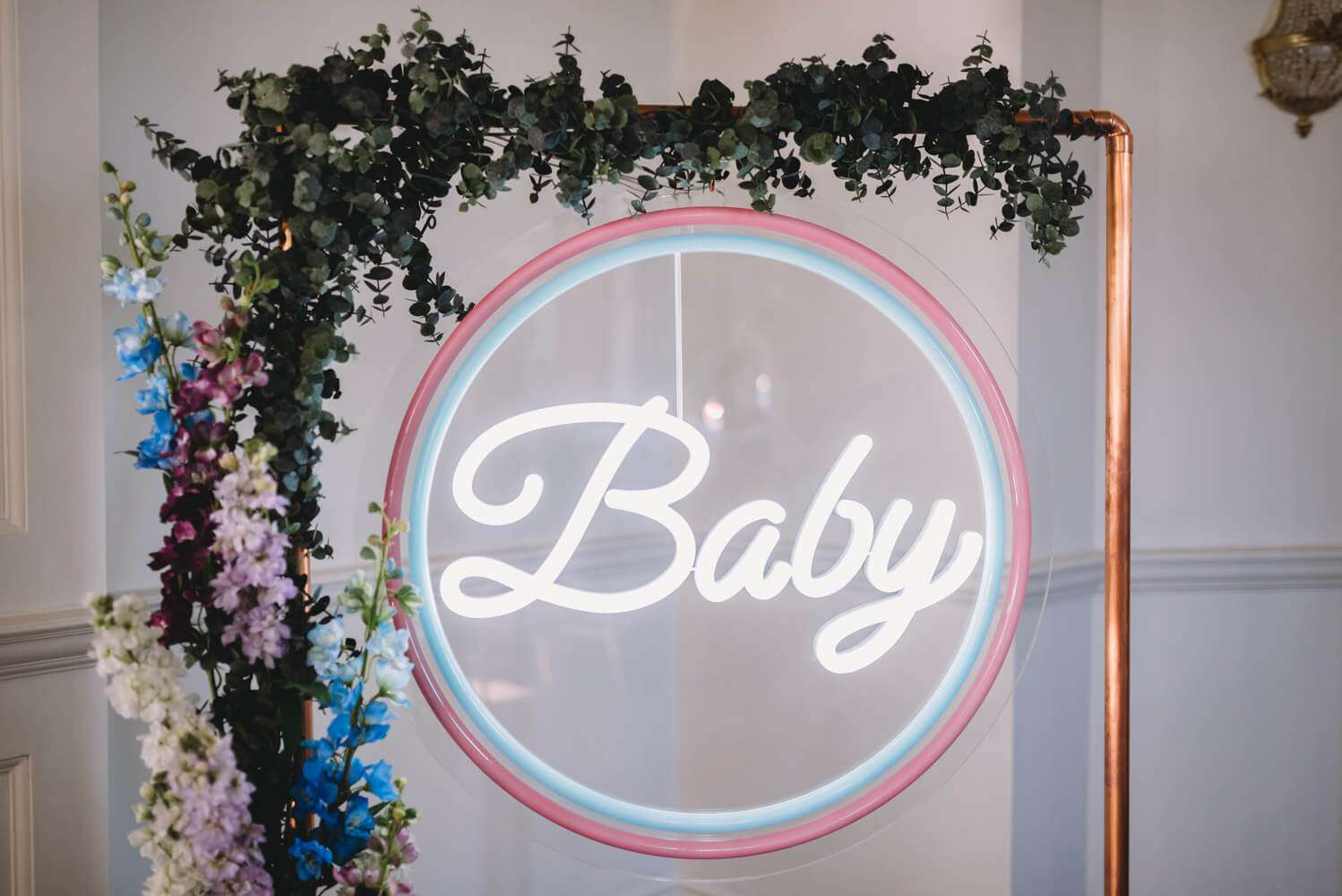 A giant neon baby sign