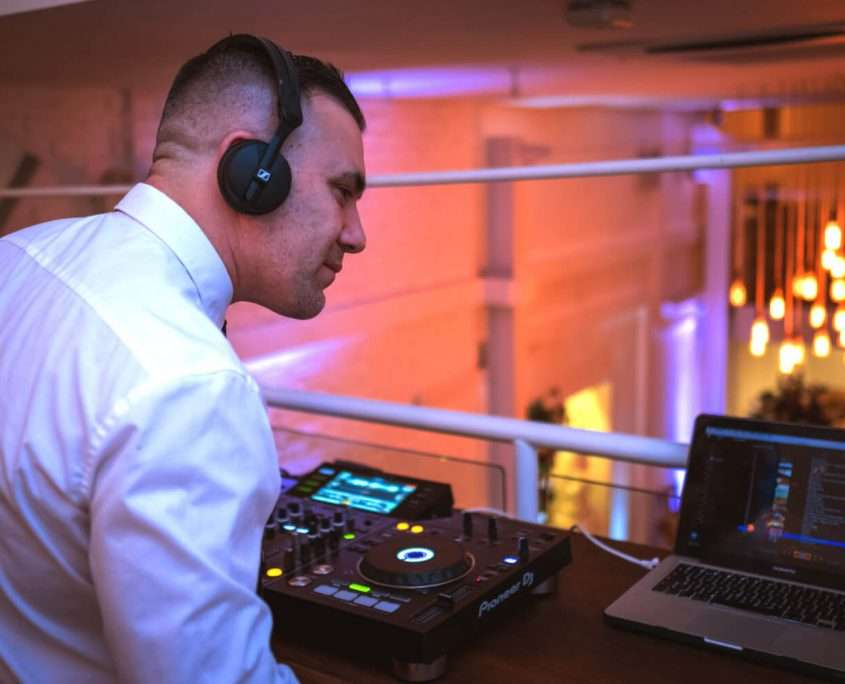 A wedding DJ playing to an excited crowd