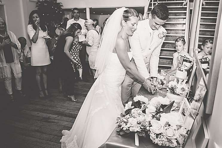 A bride and groom cutting the cake